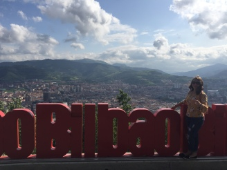 Bilbao signs with a view of the city