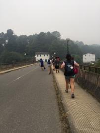 Walking across the bridge to Portomarin